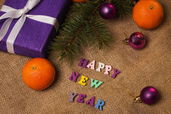 Tag Happy New Year, gift, postcard and Christmas decorations Stock Photography
