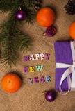 Tag Happy New Year, gift, postcard and Christmas decorations Royalty Free Stock Photos