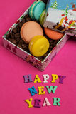 Tag happy new year, macaroons with coffee beans in the gift box Stock Image