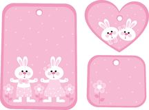 Tag with hares. Pink tag with rabbits and flowers Stock Photo