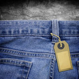 Tag lable on jeans fabric background Stock Photography
