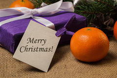 Tag Merry Christmas,gift with postcard and Christmas decorations Stock Images