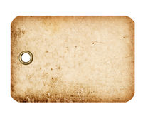 Tag with Metal Grommet. A grungy blank tag with a metal grommet isolated against a white background Stock Photo