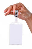 Tag name clip. In hand on the white background Royalty Free Stock Image