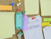 Tag name, colorful sticky notes and key on cork board Stock Photo