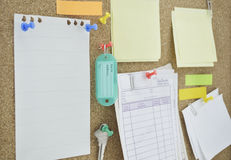 Tag name, colorful sticky notes and key on cork board Stock Images