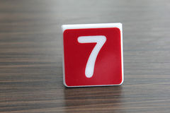 Tag number seven. On a table Royalty Free Stock Photo