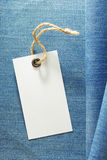 Tag price and blue jeans Royalty Free Stock Photos