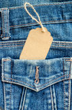 Tag price in pocket blue jean. Royalty Free Stock Images