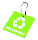 Tag with recyclable symbol. Close-up of green tag with recyclable symbol isolated on white background Stock Photo