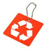 Tag with recyclable symbol. Close-up of red tag with recyclable symbol isolated on white background Royalty Free Stock Photography