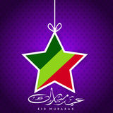 Tag or sticker with hanging star. Tag or sticker with hanging star and Arabic Islamic calligraphy of text Eid Mubarak for for celebration of Muslim community Stock Images