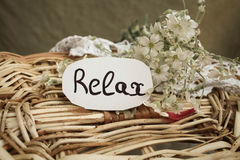 Tag with text relax. On the white flowers Royalty Free Stock Photography