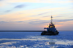 Tag vessel in the habour Stock Image
