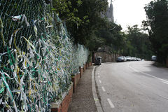 Tag wall, Barcelona Spain. Fence full of arm bands from Tibidabo amusement park in Barcelona, Spain Royalty Free Stock Image