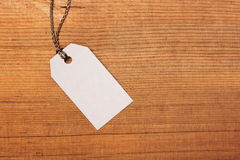 Tag on wooden background Royalty Free Stock Photography