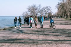 Taganrog, Russia - 07.04.19: A large number of people went for a walk on a holiday. Many happy people walk along the beautiful promenade in spring royalty free stock photos