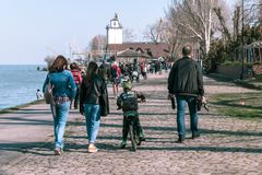 Taganrog, Russia - 07.04.19: A large number of people went for a walk on a holiday. Many happy people walk along the beautiful promenade in spring stock photo