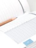 Tagebuch mit einem Bleistift Stockfotografie