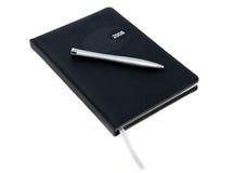 Tagebuch mit einer Feder Stockfotografie