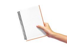 Tagebuchanmerkung in der Frauenhand Lizenzfreie Stockfotografie