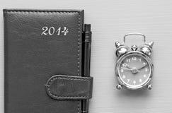 Tagesordnung und Uhr Stockfotos
