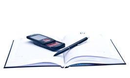 Tagesordnungstelefon und eine Feder, Geschäftssatz Lizenzfreies Stockfoto