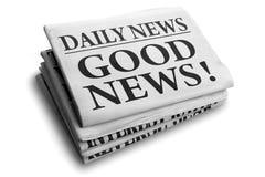 Tageszeitungsschlagzeile der guten Nachrichten Stockfotografie