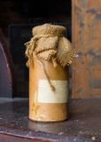 Tagged ceramic bottle close sackcloth Royalty Free Stock Photography