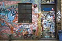 Tagged door and wall with graffiti in Williamsburg Brooklyn. Brooklyn, New York, United States - 17 August 2015 : Tagged door and wall with graffiti in Royalty Free Stock Images