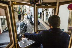 Tagged tram is making its way through a narrow stree royalty free stock photo