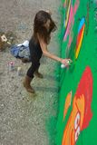 Taggers and Graffiti artist at work making vibrant artworks Royalty Free Stock Images