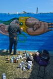 Taggers and Graffiti artist at work making vibrant artworks Stock Image