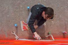 Taggers and Graffiti artist at work making vibrant artworks Royalty Free Stock Image
