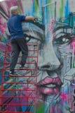 Taggers and Graffiti artist at work making vibrant artworks Stock Photos