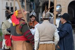 Medieval costume party. Taggia, Italy - March 17, 2018: Participants of medieval costume party in the historic city of Taggia in Liguria region of Italy. The stock photos