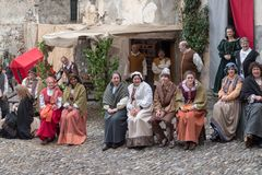 Medieval costume party. Taggia, Italy - March 18, 2018: Participants of medieval costume party in the historic city of Taggia in Liguria region of Italy. The royalty free stock photography