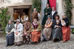 Medieval costume party. Taggia, Italy - March 18, 2018: Participants of medieval costume party in the historic city of Taggia in Liguria region of Italy. The stock photos