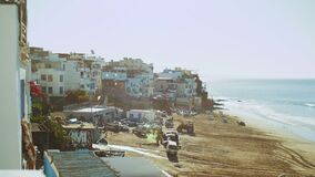 Taghazout village, Beautiful surf Taghazout village Morocco, small cozy beach gulls fly over, Atlantic Ocean, 4k