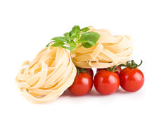 Tagiatelle pasta with tomatoes and basil Royalty Free Stock Photos