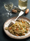 Tagilatelle with shrimp Stock Photos