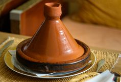 Tagin on the table in Morocco. Traditional Moroccan ceramic tajine dish Stock Photo
