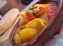 Tagine. Typical Moroccan food with potatoes, tomatoes and olives served with traditional bread Stock Photos