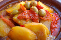 Tagine. Typical Moroccan food with potatoes, tomatoes and olives served with traditional bread Stock Images