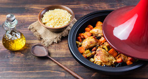 Tagine with cooked chicken and vegetables Wooden background Copy space Stock Images