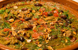 Tagine cooking - lamb chunks with vegetables Stock Photos