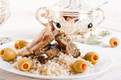 Tagine with lamb ribs, couscous and olives Stock Photos