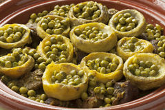 Tagine with meat, artichoke hearts and green peas Stock Photography