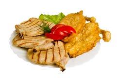Tagli del pollo grigliati isolati Fotografie Stock