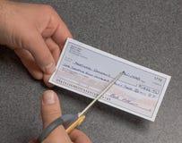 Tagli i vostri pagamenti Fotografia Stock